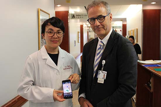 Dr. Sheila Wang (showing mobile app Swift Skin and Wound) and Dr. Greg Berry